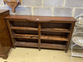 A Victorian mahogany open shelved bookcase, with bowfront centre section, length 150cm, height 31cm