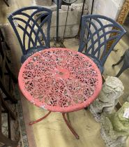 A circular painted aluminium garden table, 60cm diameter together with two garden chairs
