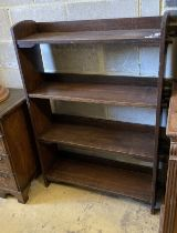 An early 20th century Wylie and Lochead style oak open bookcase, length 95cm, depth 26cm, height