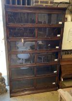 An early 20th century Gunn oak six section bookcase, length 126cm, depth 29cm, height 208cm