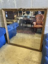 A late 19th / early 20th century giltwood and gesso overmantel mirror, width 133cm, height 138cm