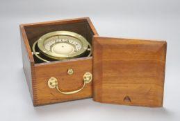 A mahogany cased brass marine compass on gimbal, marked F Smith & Son, Southampton.