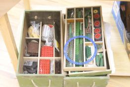 A collection of mixed Meccano pieces, in stained pine boxes