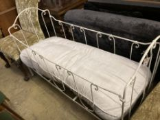 A 19th century French painted wrought iron crib, length 140cm, depth 59cm, height 90cm