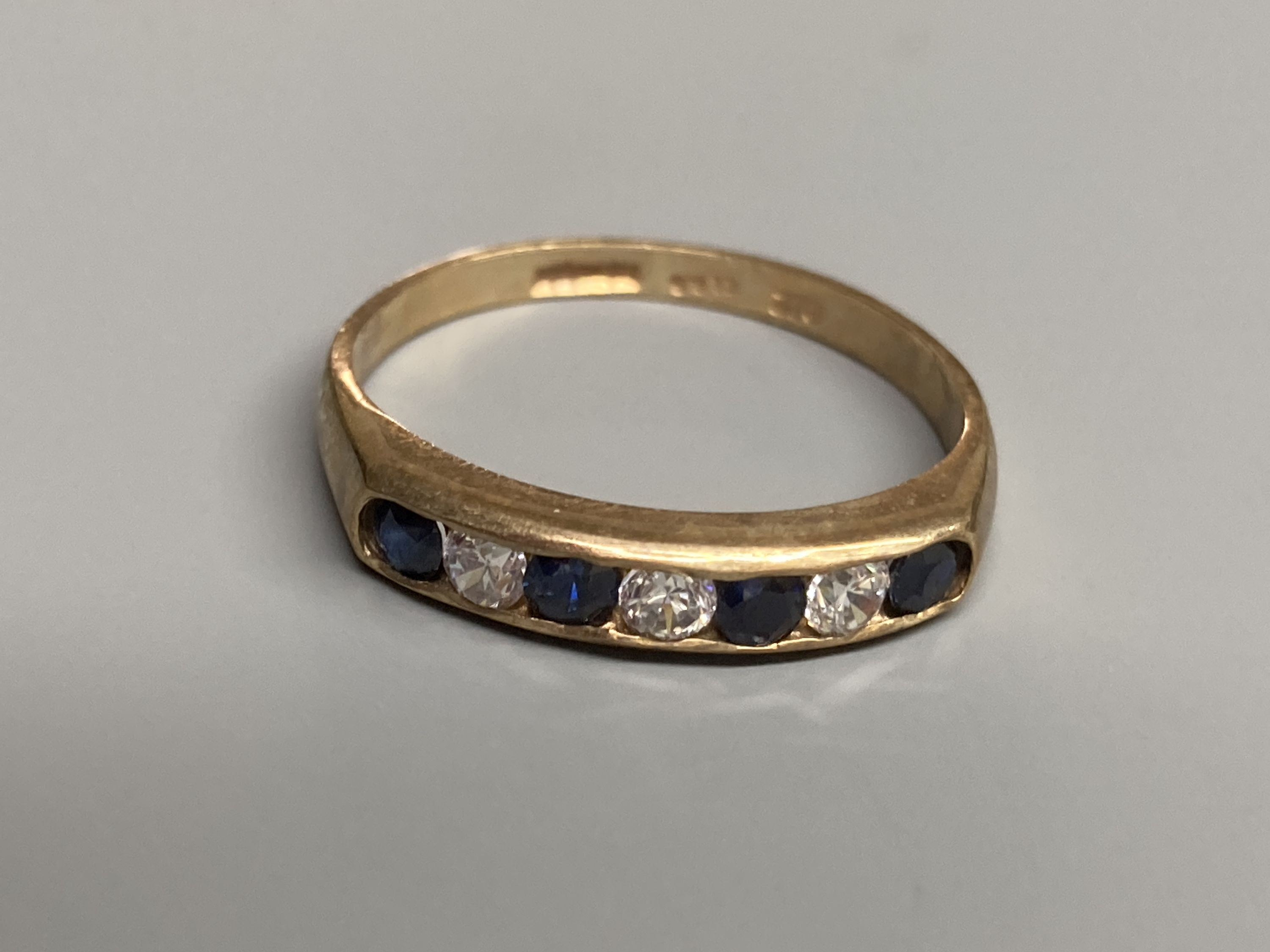 A modern 9ct gold, ruby and diamond set half hoop ring and a similar amethyst ring and two other 9ct - Image 5 of 5