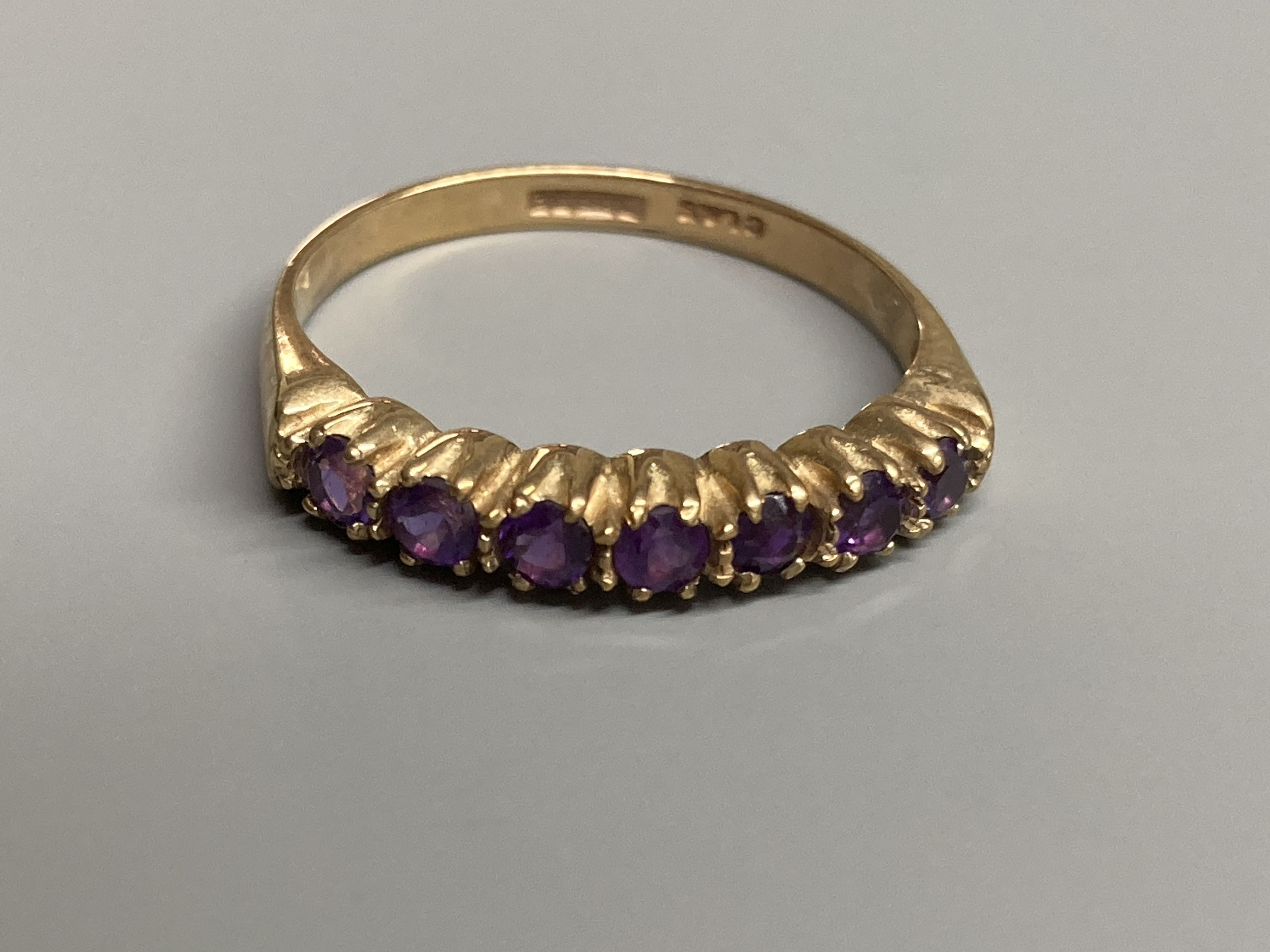 A modern 9ct gold, ruby and diamond set half hoop ring and a similar amethyst ring and two other 9ct - Image 3 of 5