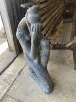 An Austin sculpture Durastone figure of a crouching girl