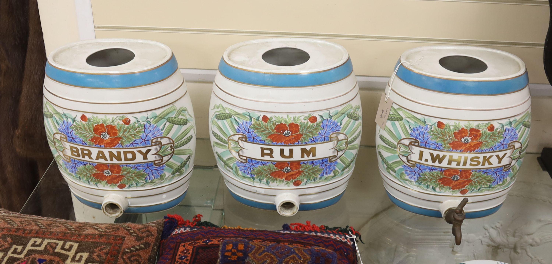 Three ceramic spirits barrels: Brandy, Rum and Whisky, 34cm high