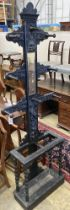 An early 20th century Flemish carved oak hall stand, width 60cm, depth 25cm, height 208cm