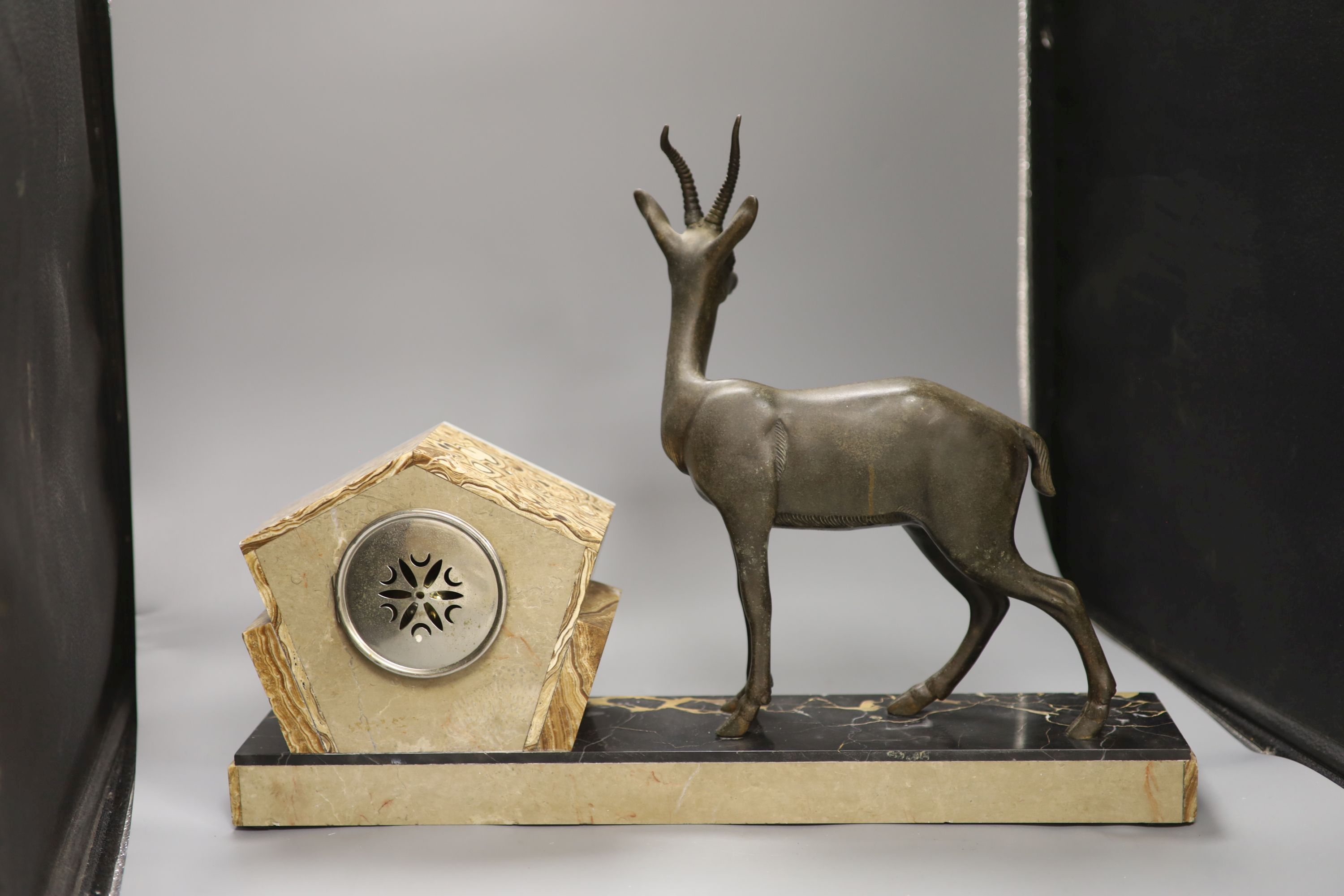 An Art Deco spelter, marble and onyx 'antelope' mantel clock, length 58cm - Image 4 of 5