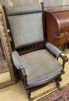 An early 20th century American mahogany rocking chair, width 60cm, depth 52cm, height 108cm