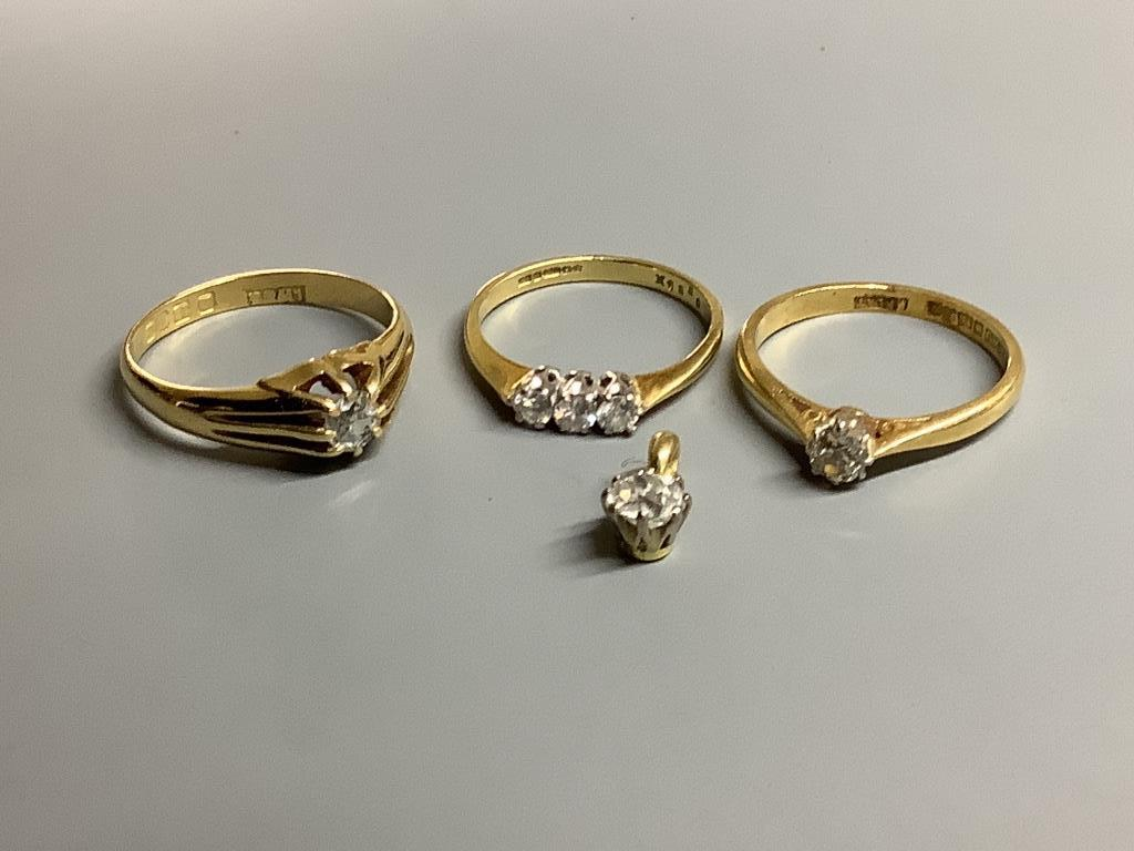 Three assorted 18 carat gold and diamond set dress rings, gross 8.3 g and yellow metal and diamond
