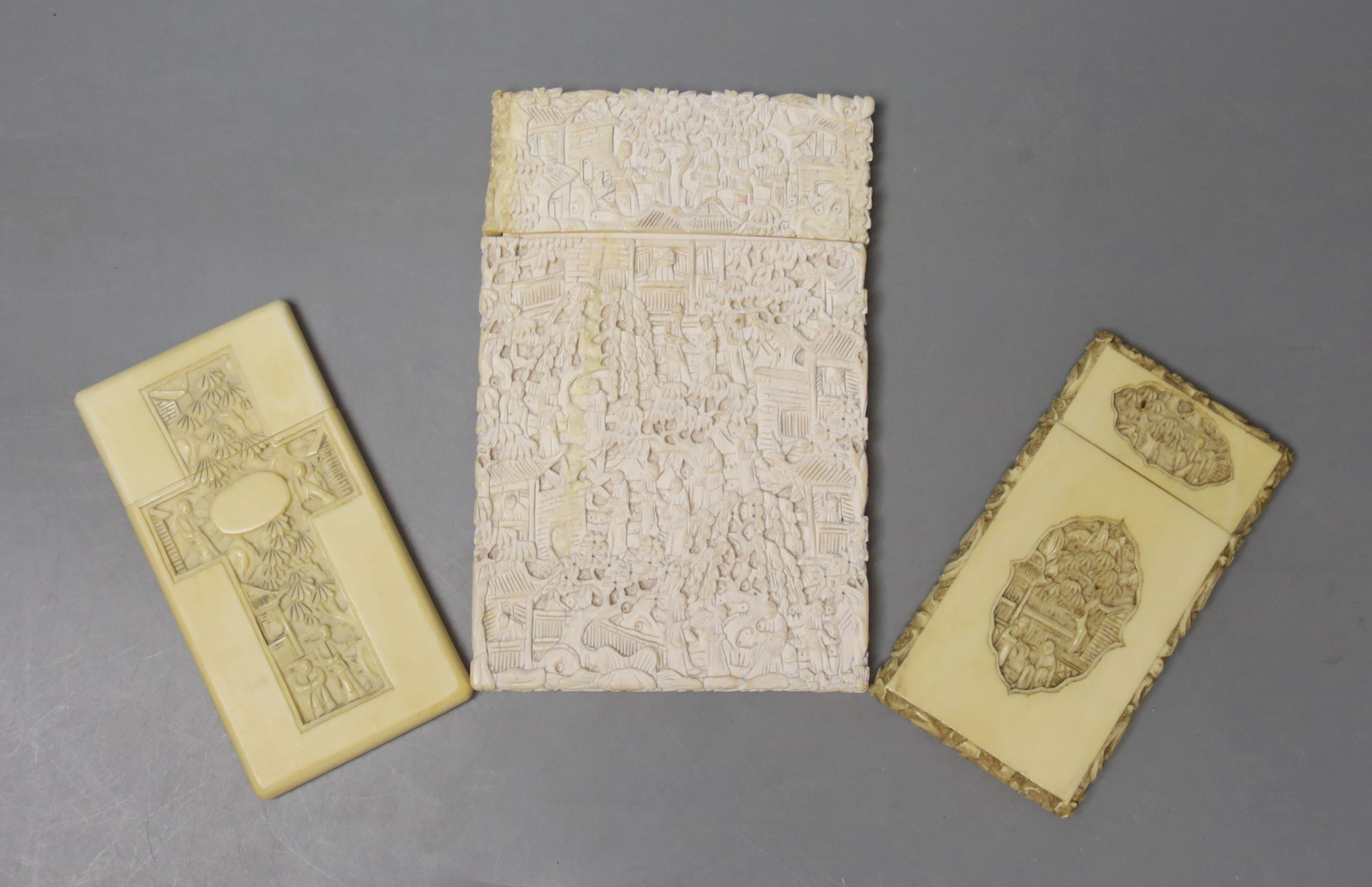 Two Chinese carved ivory card cases, largest 12 x 8cm