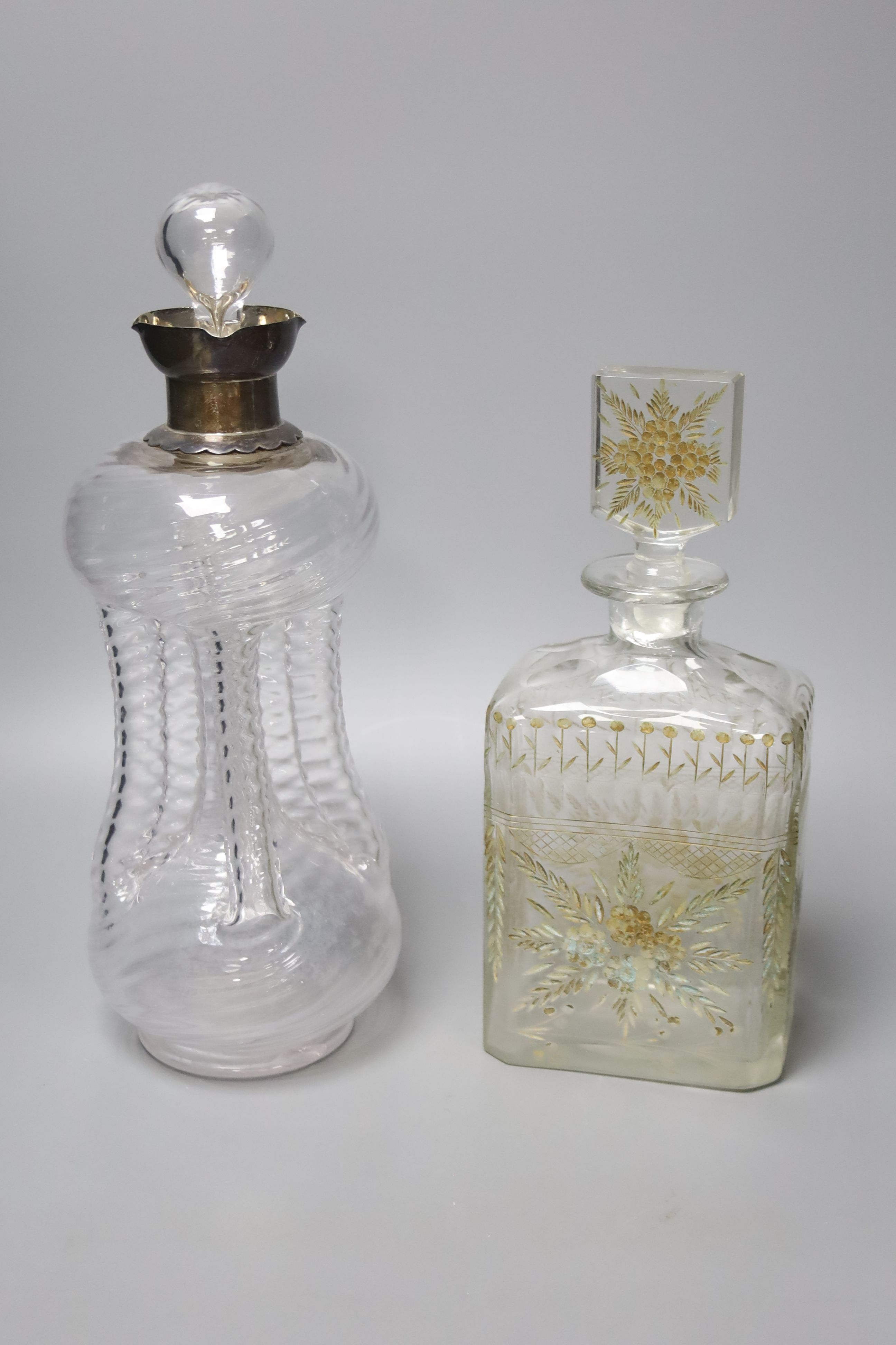 A Victorian wrythen moulded hour glass shaped decanter, with silver collar, 31cm high, togoether