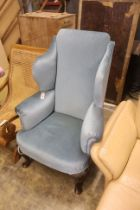 A 1920's Queen Anne style upholstered wing armchair, width 80cm, depth 70cm, height 121cm