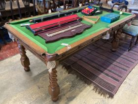 An early 20th century oak Jelks & Son snooker/dining table with full accessories, length 200cm,