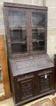 A Victorian carved oak bureau bookcase, width 94cm, depth 54cm, height 203cm