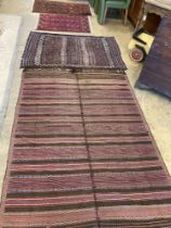 Two early 20th century flatweave rugs, a Bokhara rug and a Belouch rug, largest 220 x 160cm