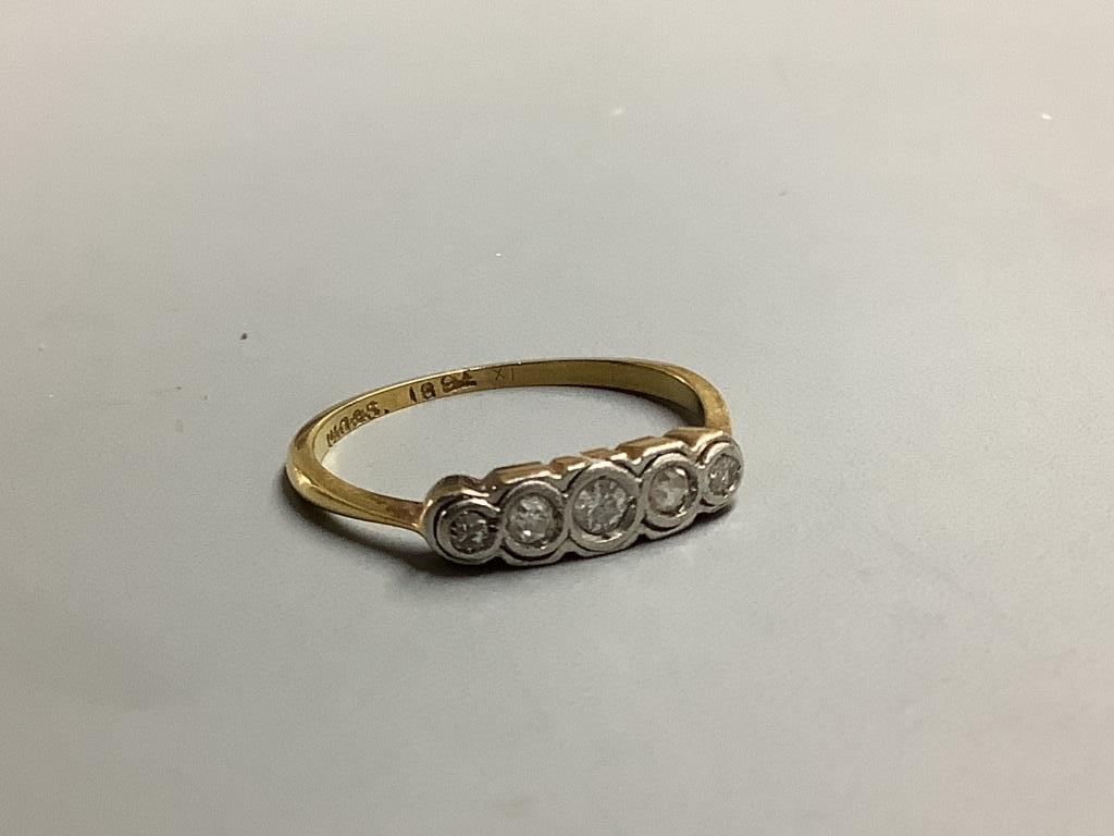 An 18ct and graduated five stone diamond ring, size M, gross 1.5 grams,
