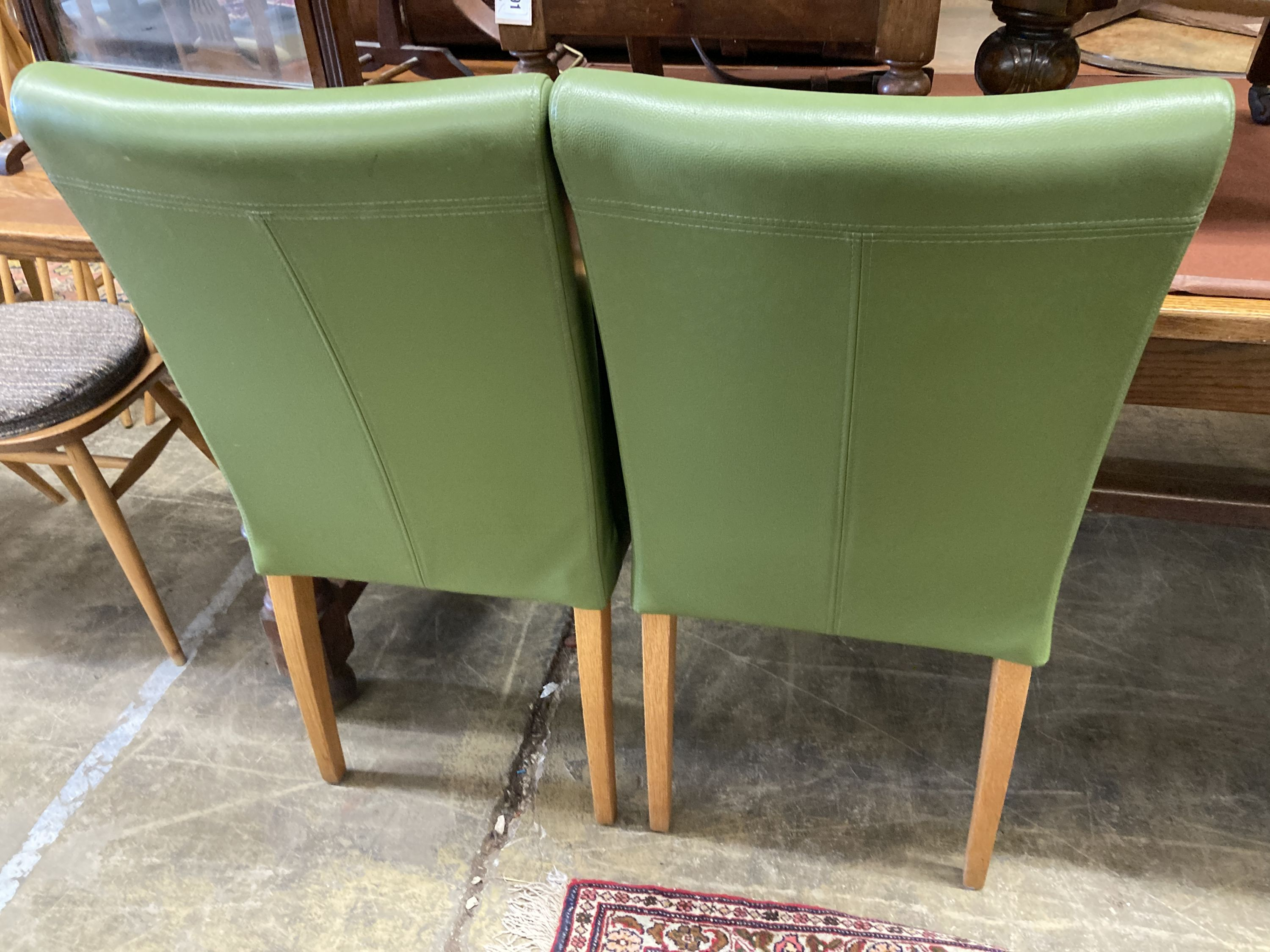 A set of eight contemporary oak and green leather dining chairs - Image 3 of 4