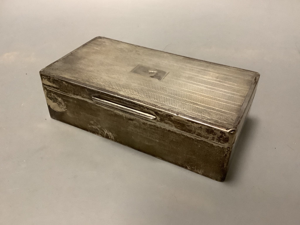 A George V engine turned silver rectangular cigarette box, Birmingham 1928,17.3 cm.