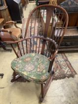 An Ercol comb back stained beech rocking chair, width 60cm, depth 50cm, height 106cm