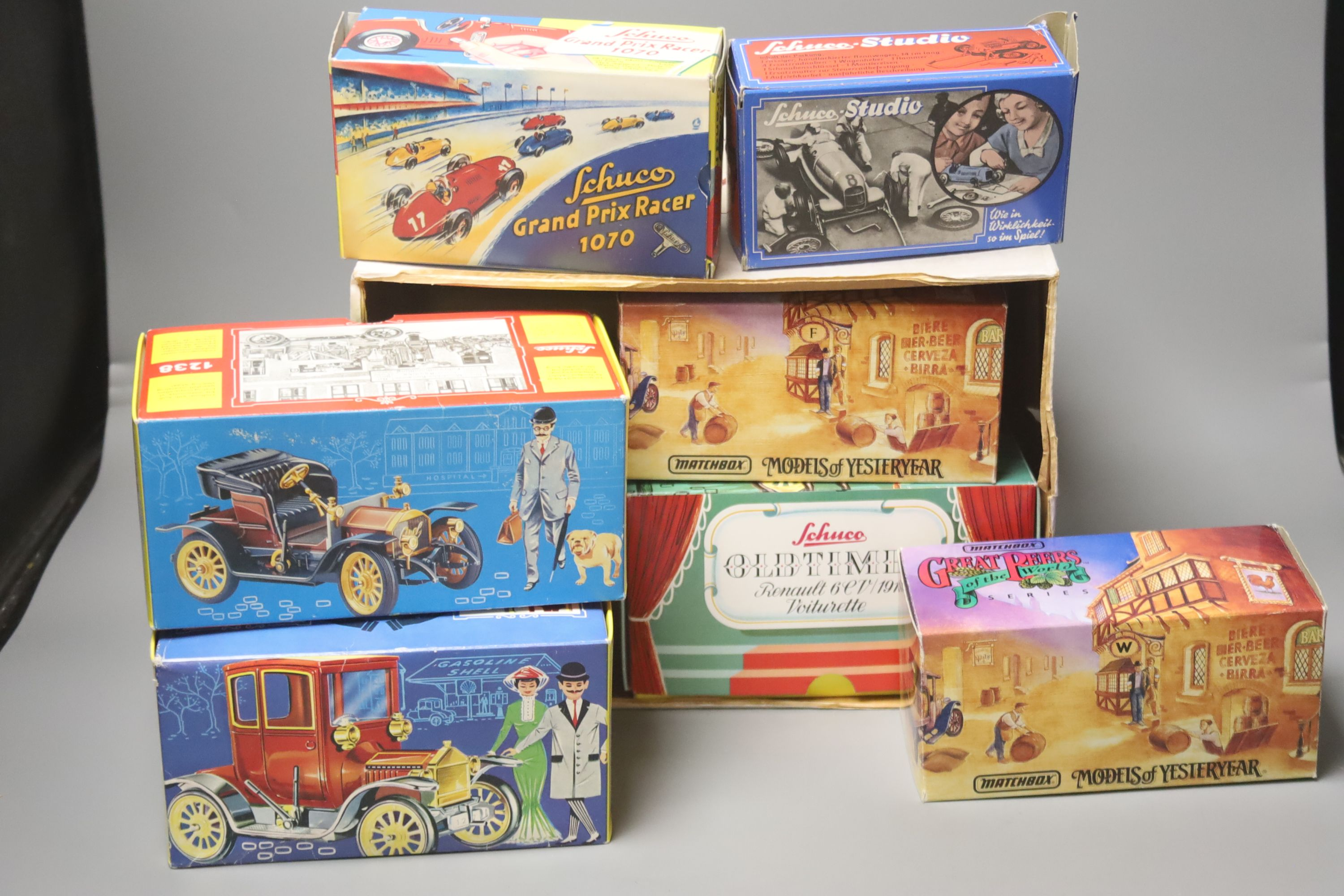 A Schuco Grand Prix Racer 1070, a Schuco Studio No. 1050, three others and two Matchbox vehicles