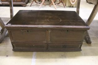 An 18th century oak trunk with dummy drawer front, width 92cm, depth 53cm, height 39cm