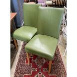 A set of eight contemporary oak and green leather dining chairs