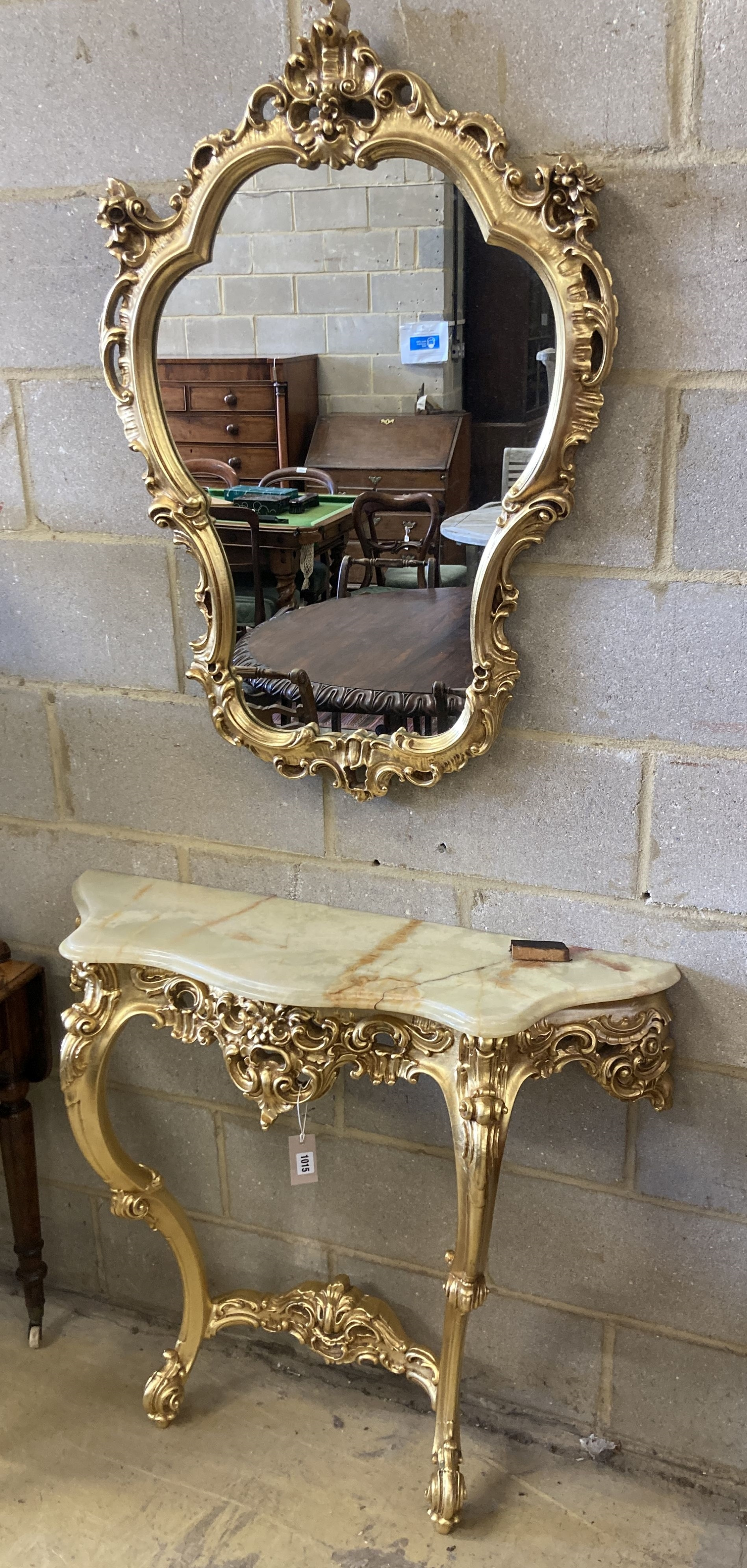 An 18th century style onyx topped gilt console table, width 94cm, depth 29cm, height 87cm with