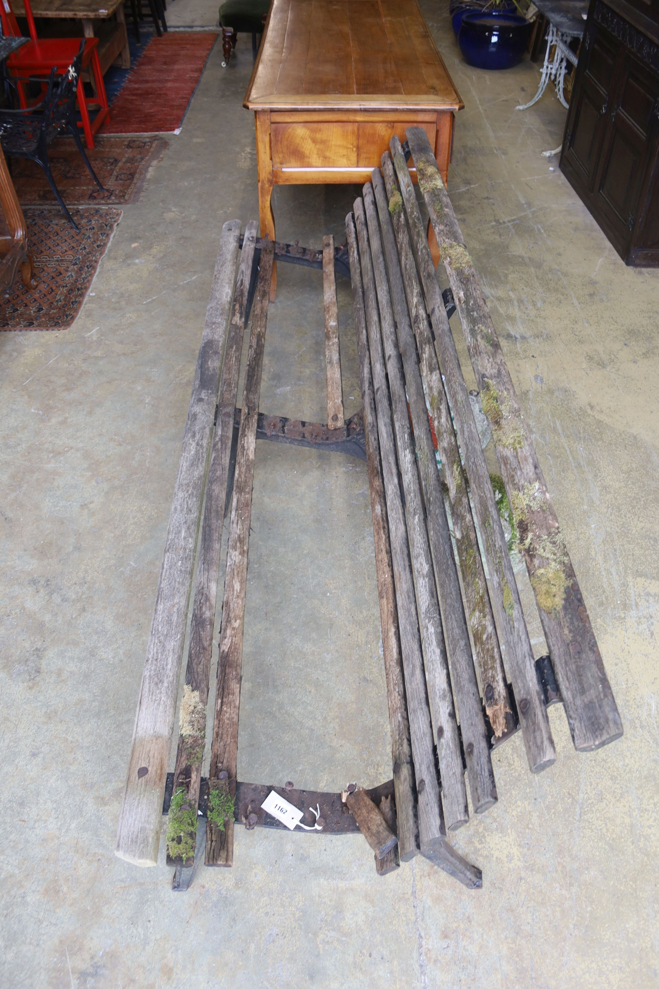 A slatted wood garden bench marked L M Furniture (in need of repair), length 244cm, depth 70cm, - Image 2 of 2