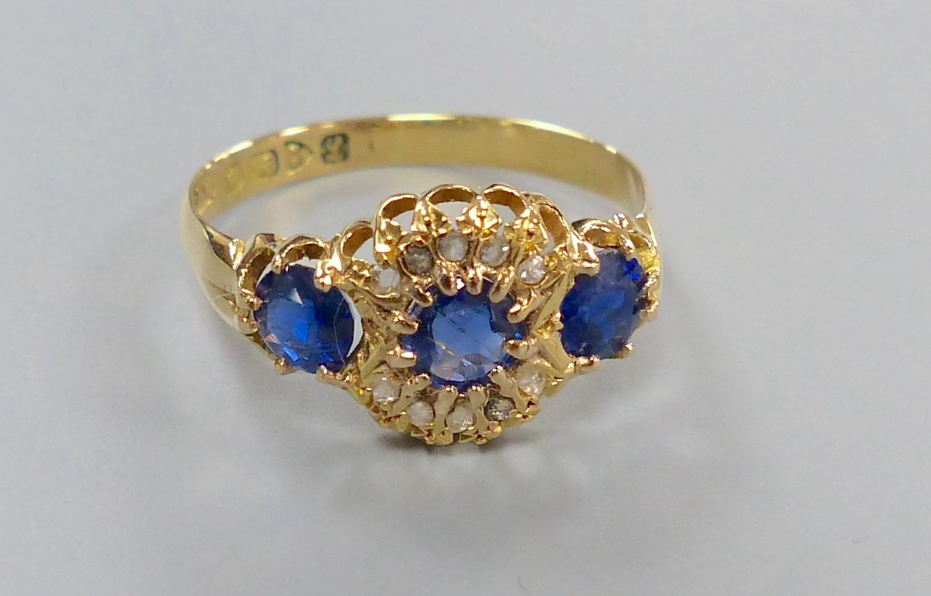 A George V 18ct gold, sapphire and diamond chip cluster dress ring, size R/S, gross 2.7 grams.