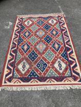 A Kelim flatweave polychrome geometric carpet, 240 x 160cm