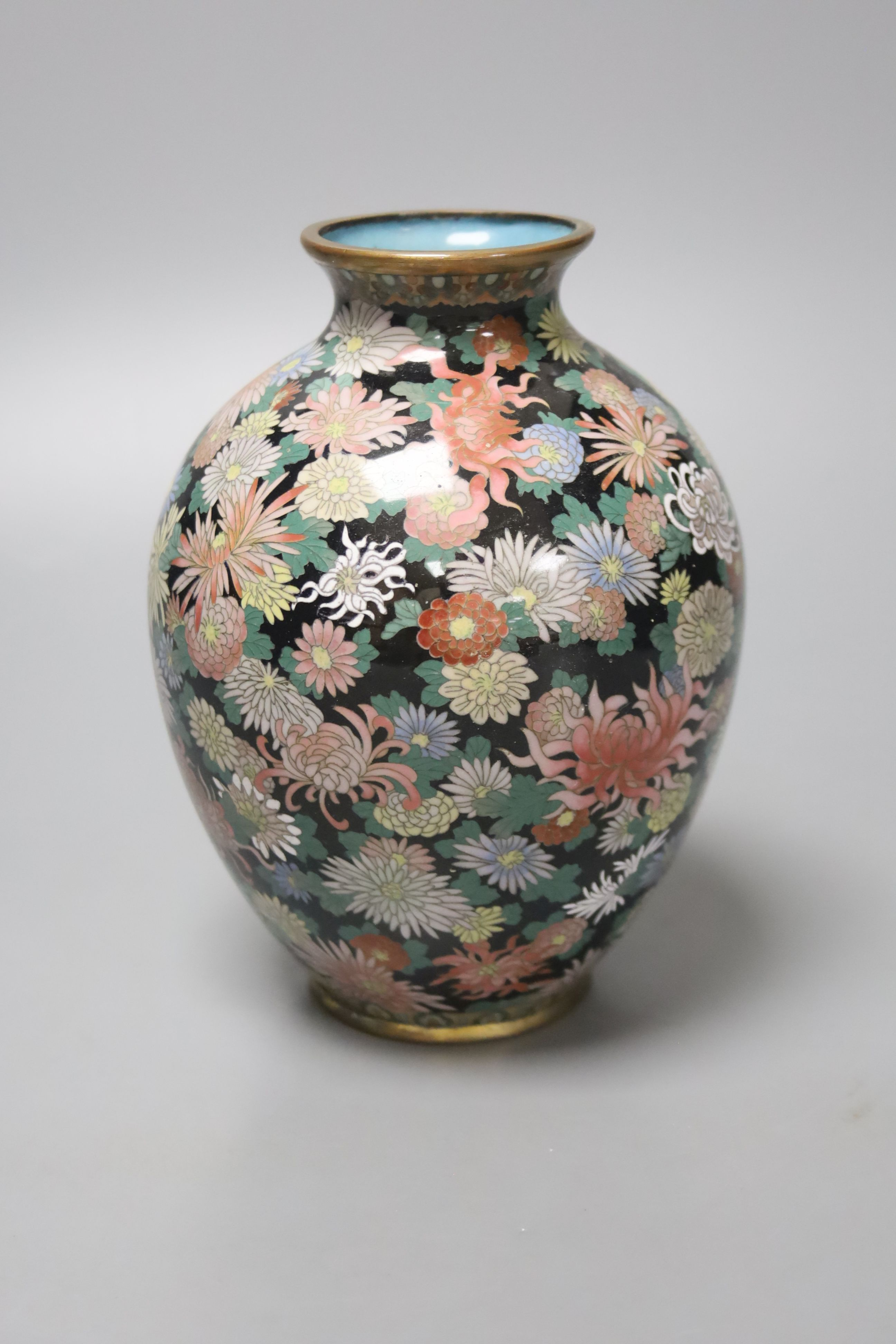 A Japanese silver wire cloisonne vase, decorated with flower heads, possibly Inaba, 16cm high