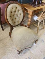 A Victorian walnut spoonback nursing chair