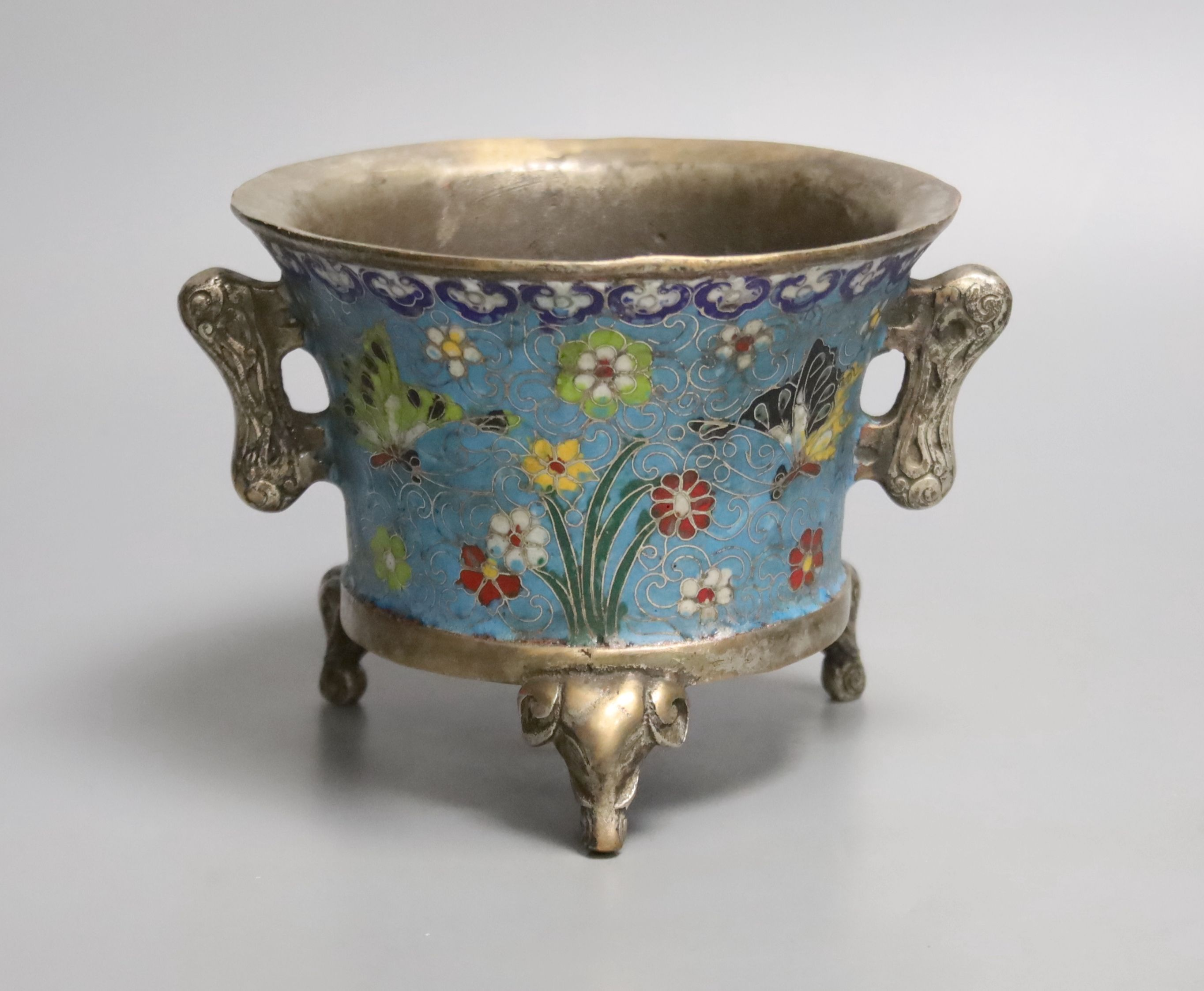 A heavy Chinese silvered bronze twin handled censer with floral decoration, a four character