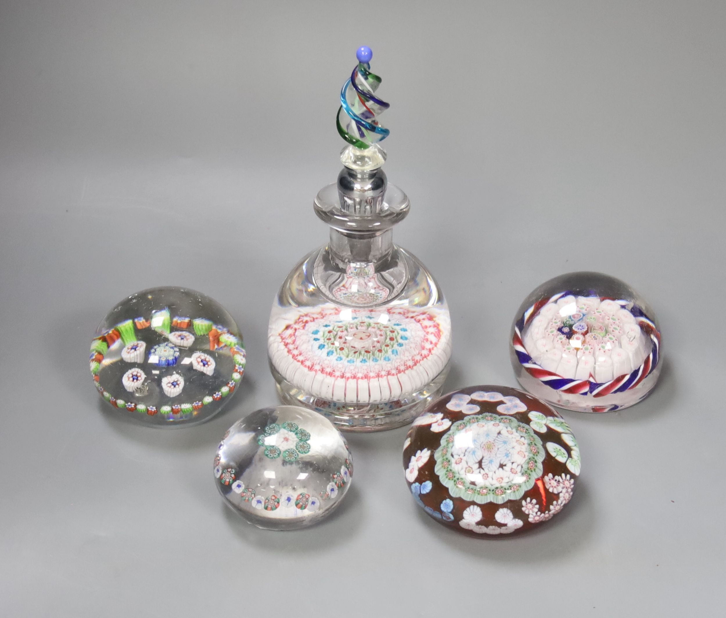 A millifiore inkwell and four weights