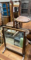 An Edwardian mahogany folding cake stand together with a mahogany toilet mirror
