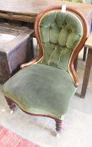 A Victorian mahogany spoon back nursing chair