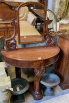 "A Victorian mahogany 'D' shaped ""Duchess"" dressing table, width 90cm, depth 40cm, height 129cm"