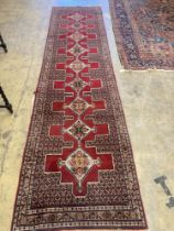 A North West Persian red ground runner, 380 x 94cm