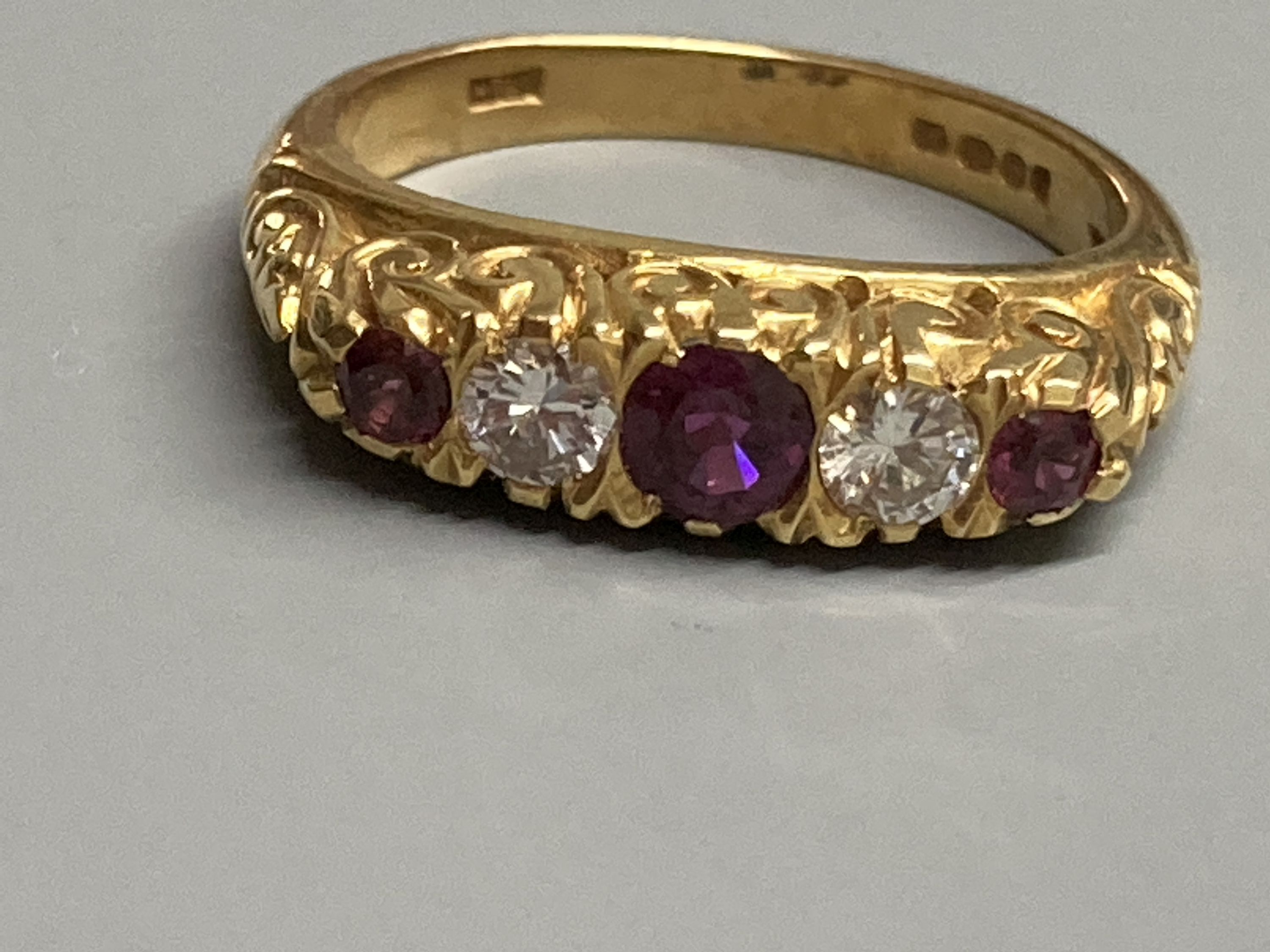 A modern Victorian style 18ct gold, three stone ruby and two diamond set half hoop ring, size N, - Image 2 of 3
