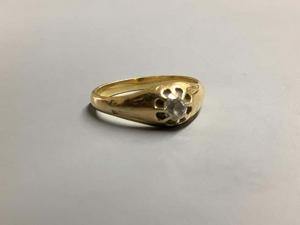 A yellow metal and claw set solitaire diamond ring, size P/Q gross 4.8 g.
