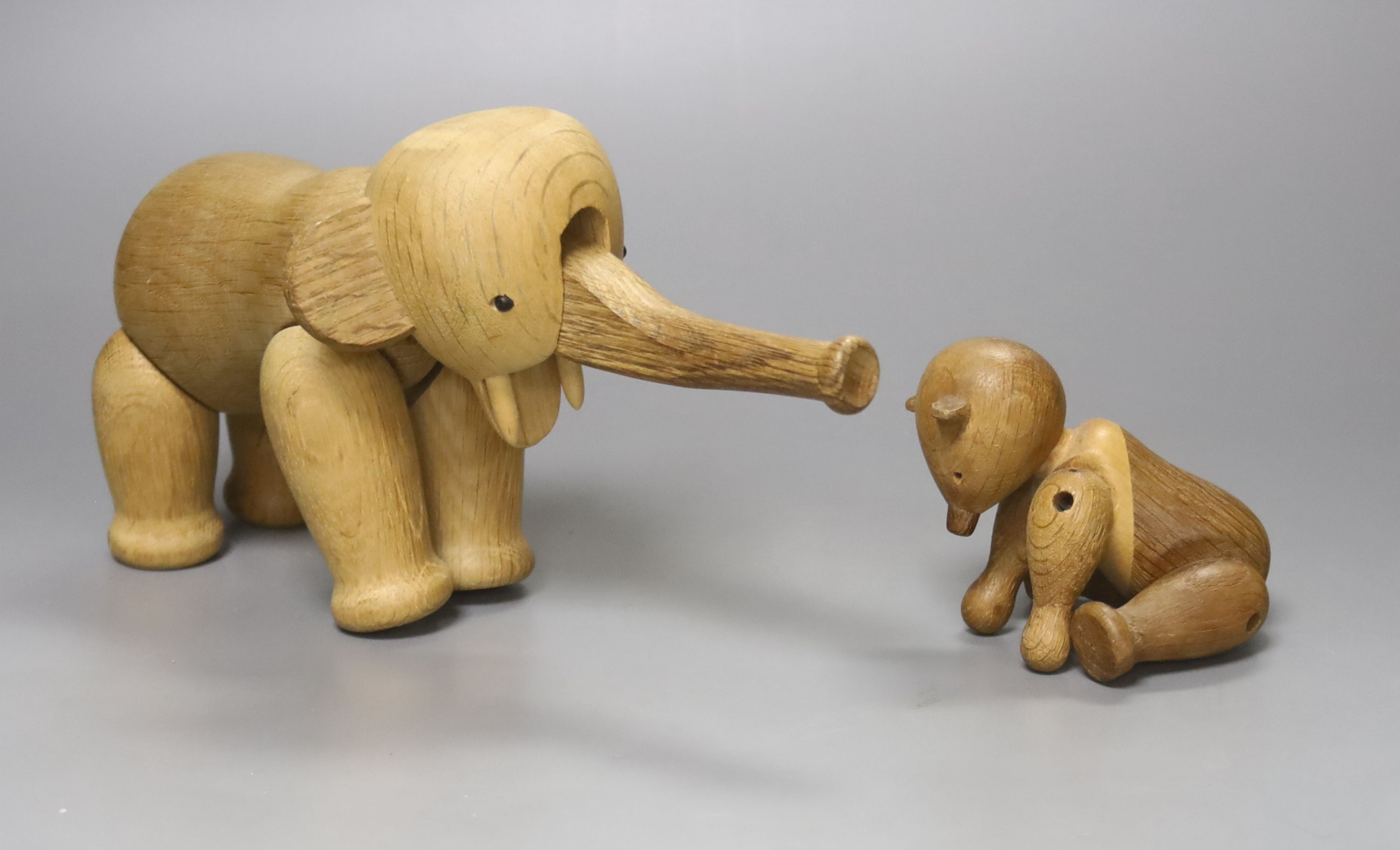 Two Danish carved wooden toys by Kay Bogesen, a standing elephant, 22cm length 14cm high and a