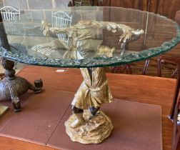 A reproduction Blackamoor table with circular glass top, diameter 80cm, height 63cm