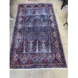 An Isphahan blue ground rug, 248 x 140cm