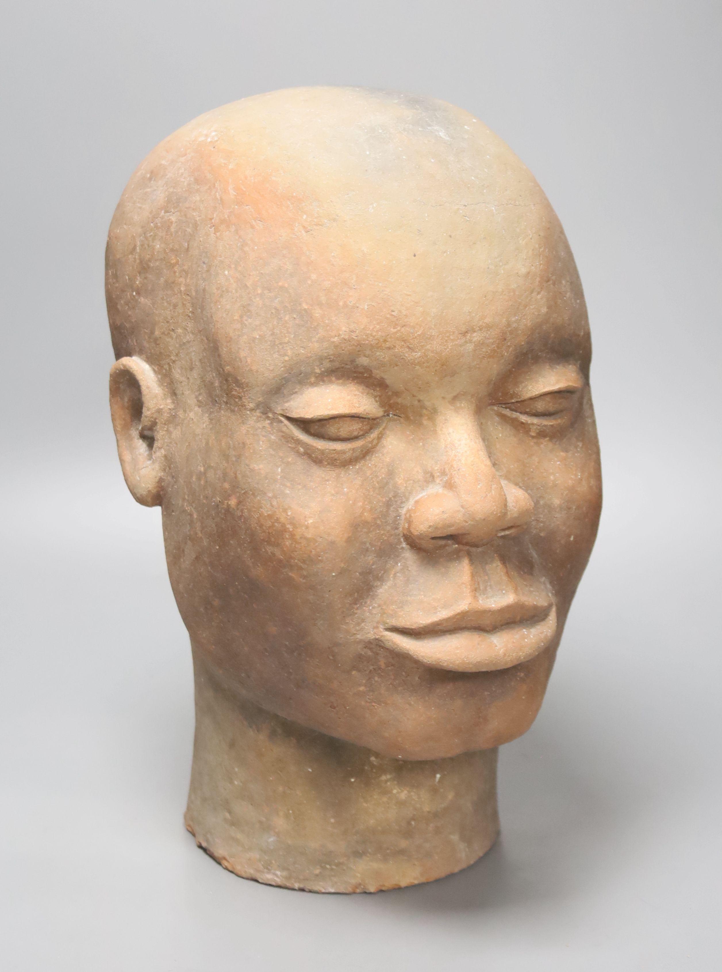 A large decoative terracotta head, 33cm high