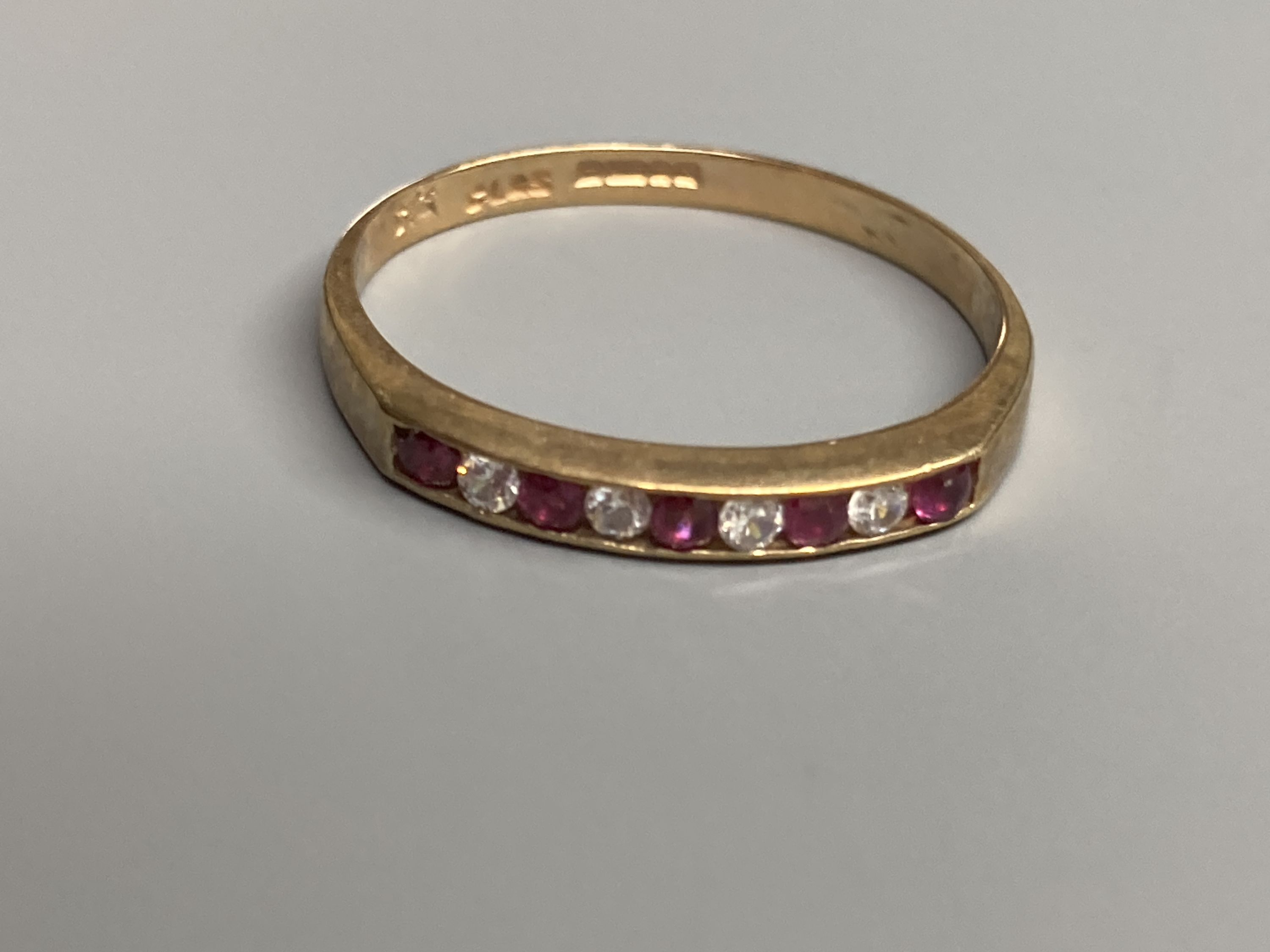 A modern 9ct gold, ruby and diamond set half hoop ring and a similar amethyst ring and two other 9ct - Image 4 of 5