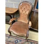 A Victorian walnut spoonback open armchair