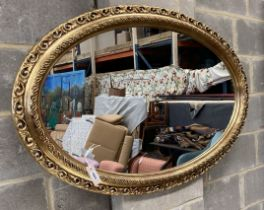 Two Victorian style oval gilt frame wall mirrors, larger 114cm, height 74cm